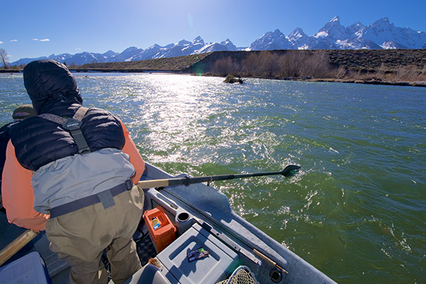 Fishing Jackson Hole Josh Gallivan rowing his boat into perfect fly fishing postion