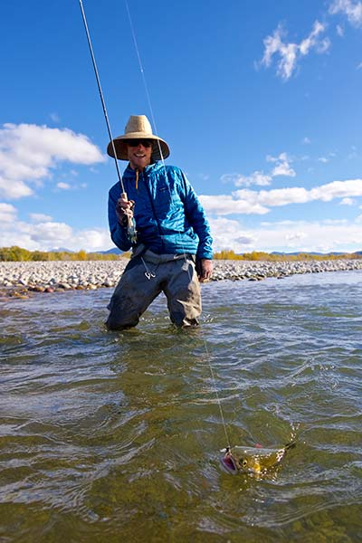 Jackson Hole Fly Fishing Guide Josh Gallivan reeling in a fish