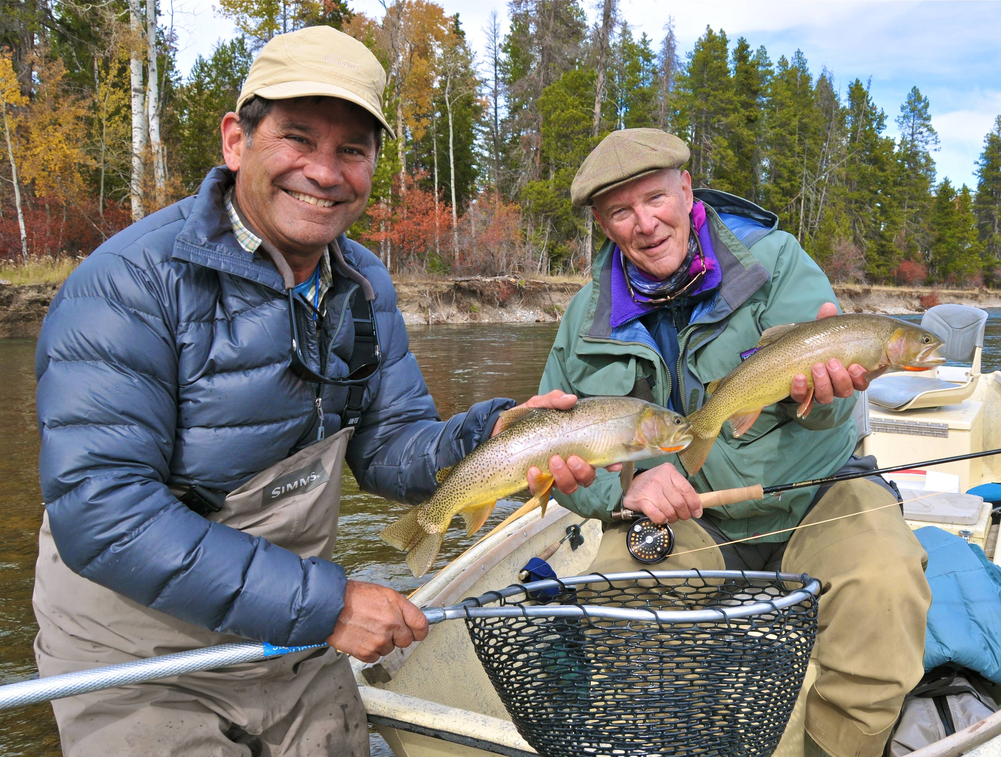 Snake River fly fishing guides and clients with trout in hand