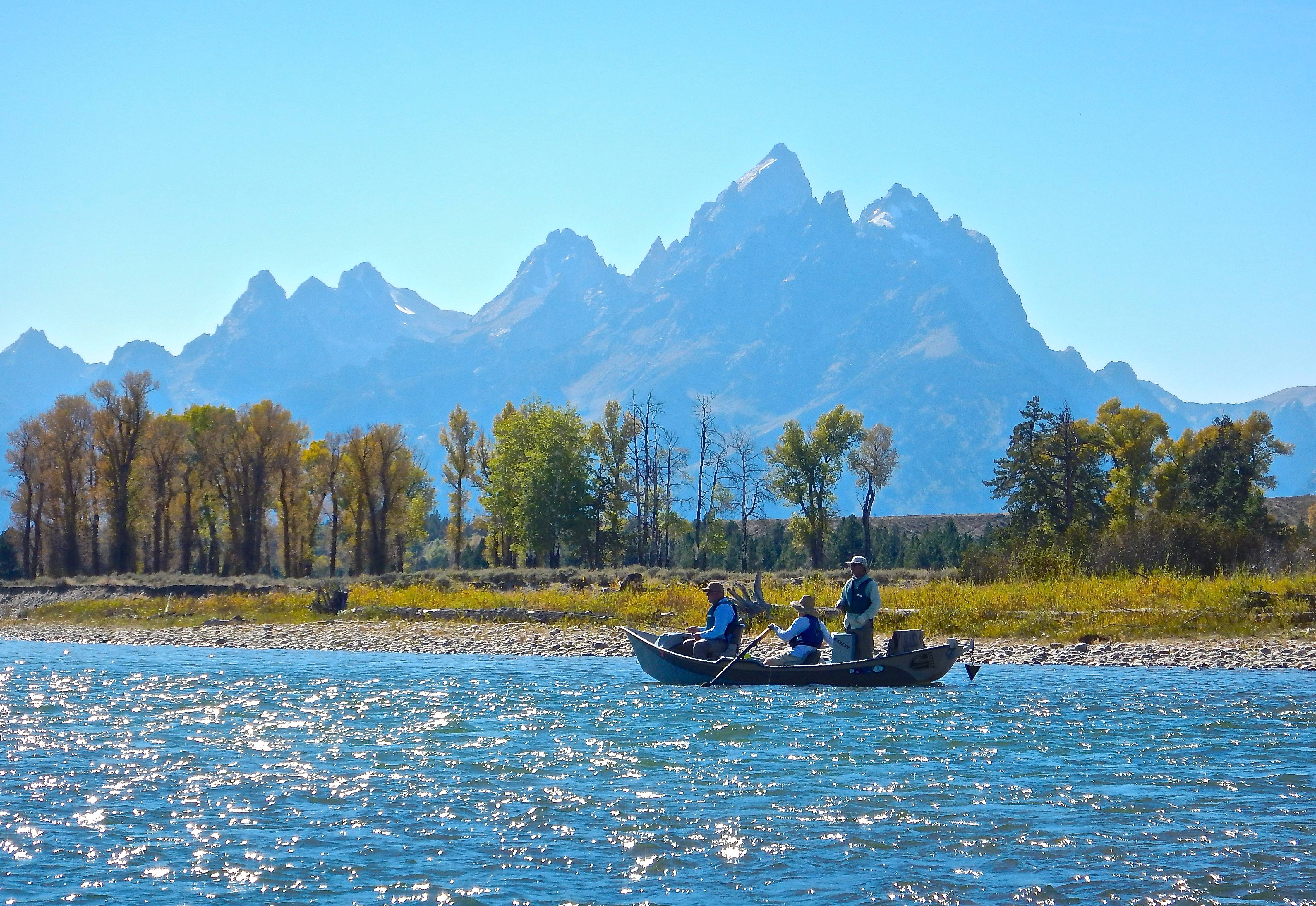 Snake River guide with client floating down the snake river
