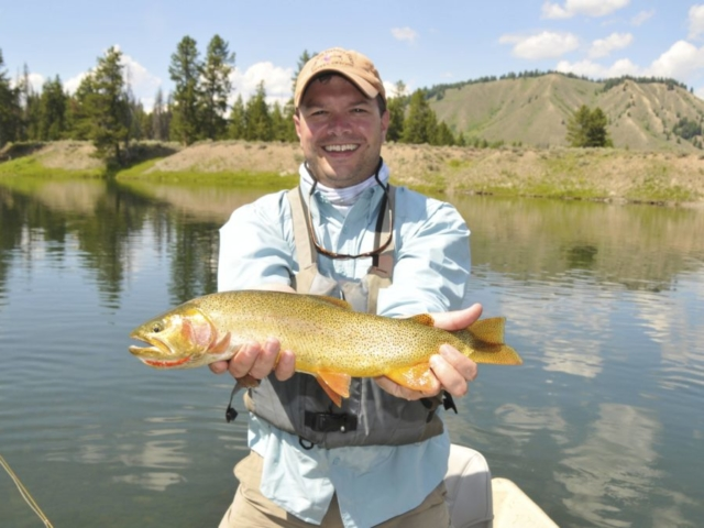 Snake River happy client with trout in hand