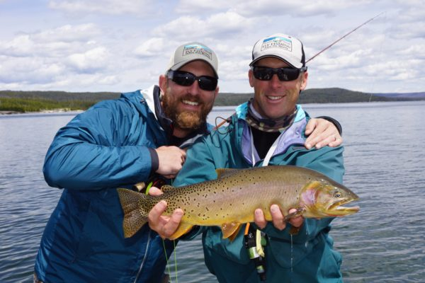 yellowstone lake fishing guides with client and big trout